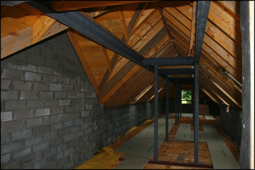 Interior view of the residential conversion of Goodtree Steading, Balerno, Edinburgh showing metalwork from Blake Group.