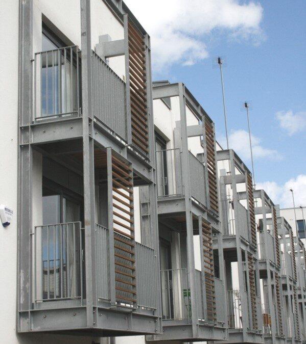 Steel balconies on Miller Homes townhouses in Edinburgh by Blake Group