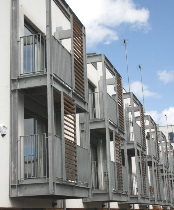Steel balconies on Miller Homes townhouses in Edinburgh by Blake Group