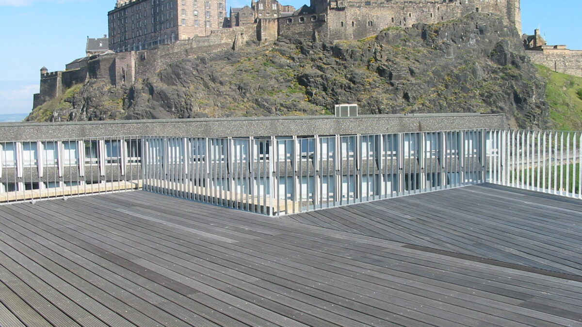 Edinburgh Castle with steel railings in foreground by Blake Group