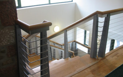 Metal and steel stairs and balustrade by Blake Group in Platinum Point flats.