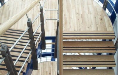 Beautiful metal and wood staircase for BAM Construction office development by Blake Group